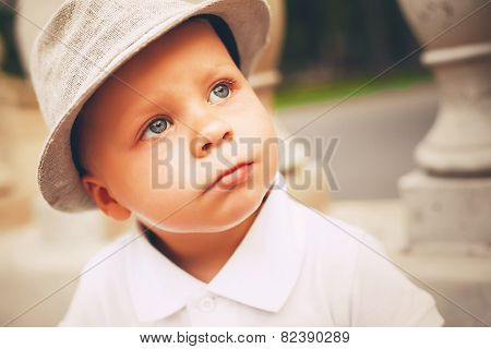 Thoughtful Cute Boy In Hat