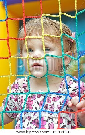 young girl in bounce house