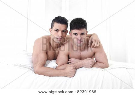 Young Attractive Gay Men Couple Lying On Bed Together In Love With Naked Torso Homosexual Relationsh