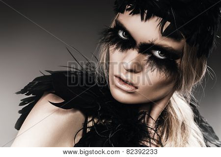 Aggressive Woman With Black Feathers On Eyes