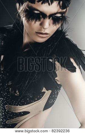 Attractive Woman With Black Feathers On Shoulders