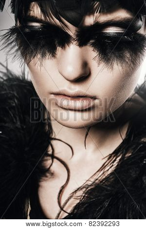 Mysterious Woman With Black Feathers Of Face