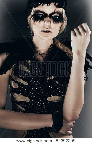 Portrait Of Attractive Woman In Black Feather