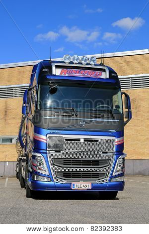 New Volvo FH Tank Truck By A Warehouse, Vertical View