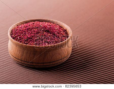 Sumac In A Wooden Bowl