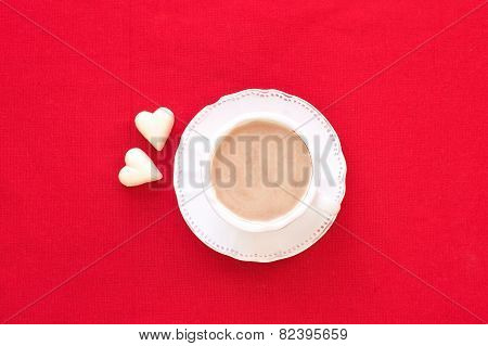 Valentine's Day coffee Cup With Two Heart Shaped White Chocolates.