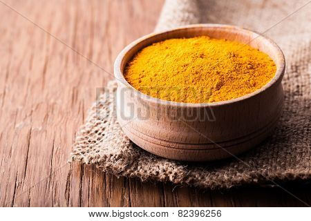 Dry Spice Turmeric In A Wooden Bowl Close-up
