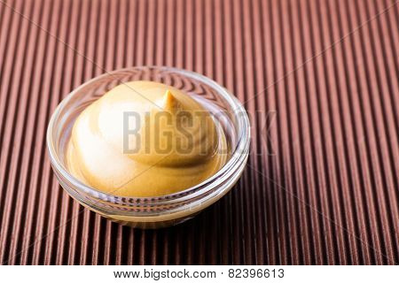 Mustard In A Glass Bowl Close-up