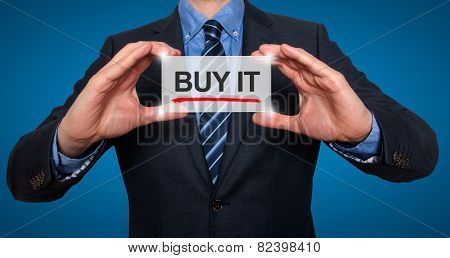 Businessman Holding Buy it Sign