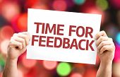 stock photo of reaction  - Time for Feedback card with colorful background with defocused lights - JPG