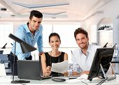 stock photo of team  - Happy team of young business people working together in office - JPG