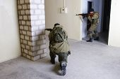 pic of ak 47  - rebels with AK 47 inside the building - JPG