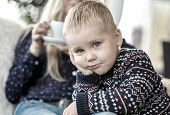 stock photo of sensory perception  - Blond Child looking at camera - JPG