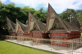 stock photo of southeast  - Traditional Batak houses on Samosir island Sumatra Indonesia Southeast Asia - JPG