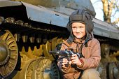 picture of panzer  - Portrait of young boy with gun playing near by panzer - JPG