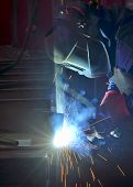 image of manufacturing  - welder working with electrode at semi - JPG