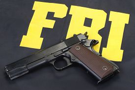 image of colt  - colt government m1911 handgun on fbi uniform - JPG