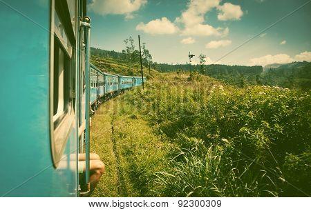train from Nuwara Eliya to Kandy among tea plantations in the highlands of Sri Lanka - retro style postcard