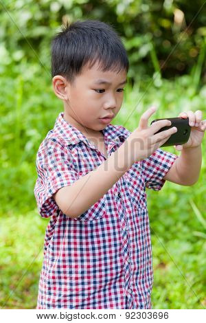 Little Boy Taking Photos By Digital Camera On Smartphone With Good Intentions