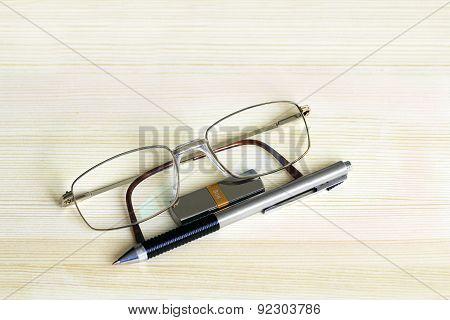Eyeglasses, Pen And Usb Drive Memory