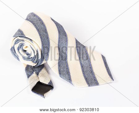 striped necktie roll isolated on white background
