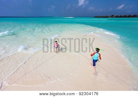 Above view of kids running and having fun at beach
