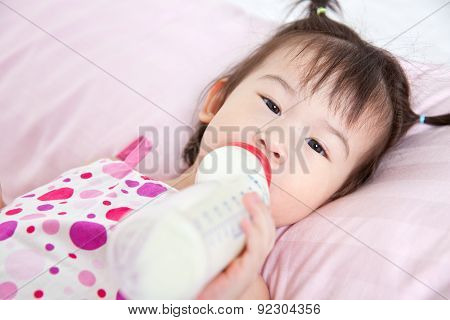 Beautiful Little Asian Girl Lying And Suck Up Milk
