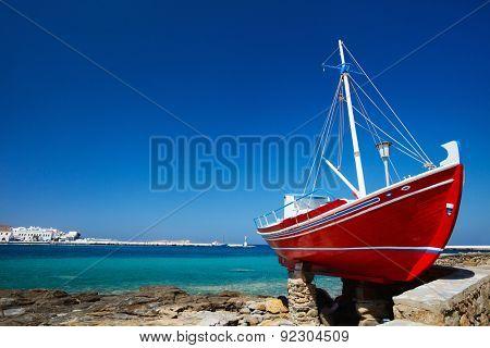 Red boat on island of Mykonos, Greece