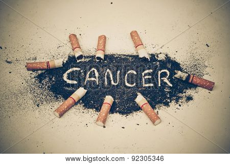 cigarette ash with a  text saying cancer