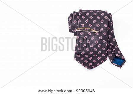 tie roll with tie clip isolated on white background