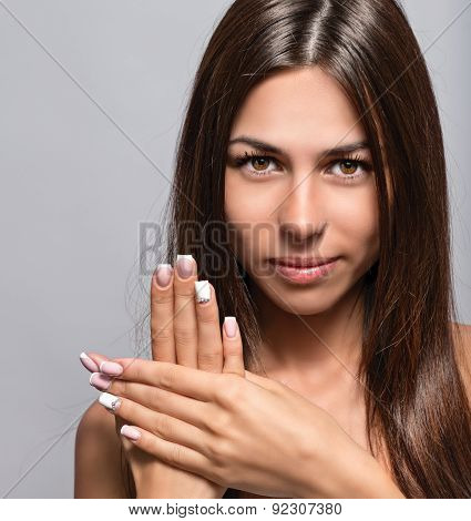 Portrait of a beautiful young woman with a nice manicure