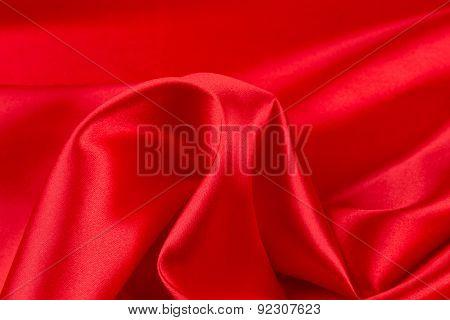 Red silk drapery. Close up.