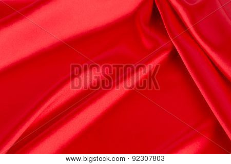 Red silk drapery close up.