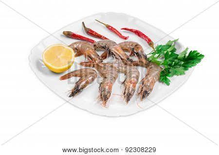 Fresh shrimps on plate with pepper.