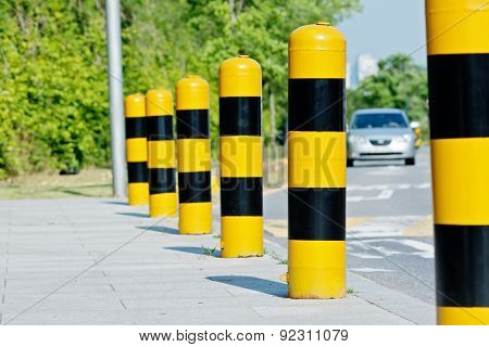 Yellow and black road safety studs with selected focus