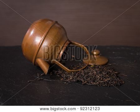 Scattered Dry Tea Leaves And Vintage Teapot