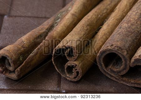 Cinnamon Sticks Close-up On Brown Background
