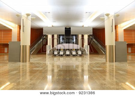 Big Modern Hall With Granite Floor, Columns And Two Escalators In Airport, General View