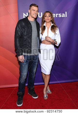 LOS ANGELES - APR 02:  Alan Ritchson & Nicole Scherzinger arrives to the NBCUniversal's Summer Press Day 2015  on April 02, 2015 in Hollywood, CA