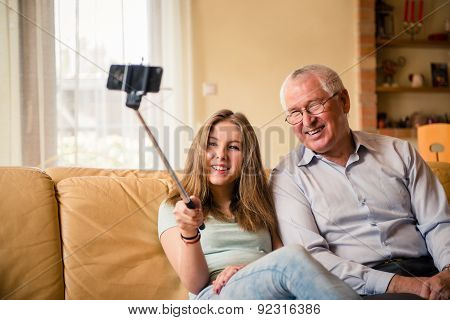 Grandfather with grandchild selfie