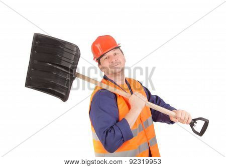Worker in hard hat holding shovel.