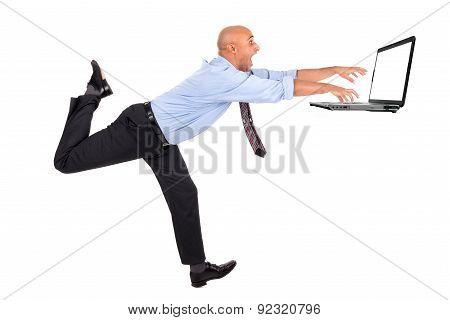 Businessman Chasing Laptop