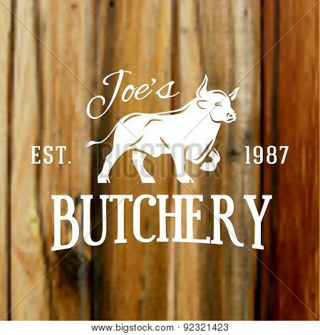 Premium vintage beef bull label on blurred wood background. Vector butchery logo design