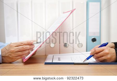 Inspector And Auditor Are Inspecting Legal And  Financial Documents