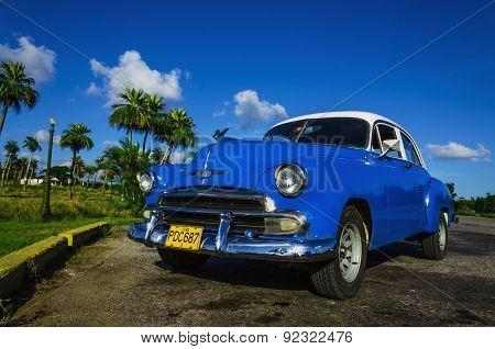 Blue classic American car in Havana, Cuba