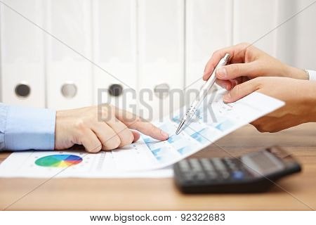 Two Business People On Meeting  Analyze Financial Report  And Discussing About Data