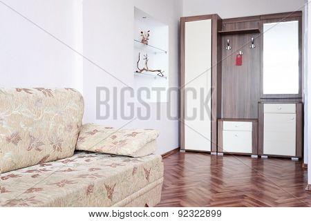The image of a wardrobe and sofa