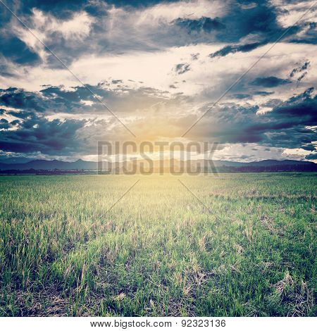 Vintage Photo Of Storm Clouds And Field Meadow With Sunset