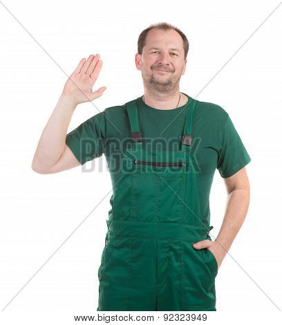 Worker in green overalls.