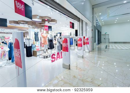 Sale sign in clothes shop